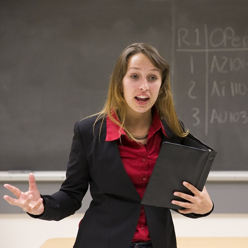 A female instructor conducting in her class